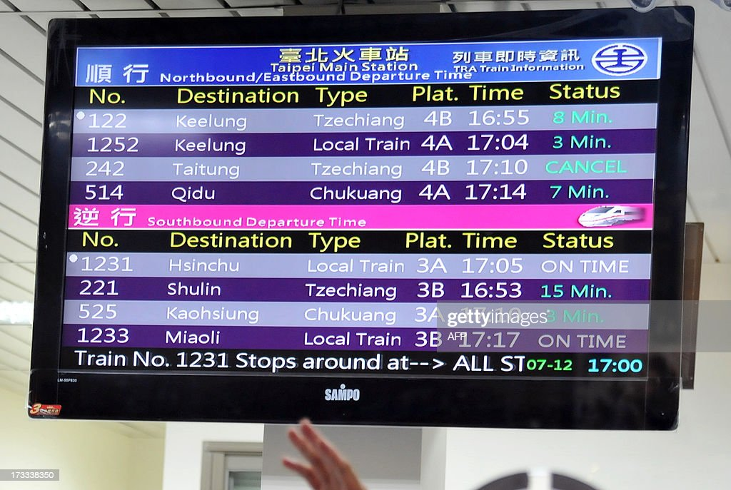 An electronic board showing disruptions to train travel is displayed at Taipei's main station as Typhoon Soulik approaches northern Taiwan on July 12, 2013. Hundreds of villagers were evacuated and schools and businesses shut down in Taiwan on July 12 as it prepared for the arrival of Typhoon Soulik, expected to pound the island with powerful winds and heavy rain over the weekend. AFP PHOTO / Mandy CHENG