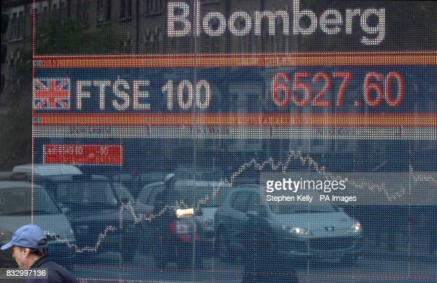 An electronic board shows the FTSE 100 index in west London
