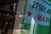 An electronic display shows the closing figure of the Hang Seng Index at the Hang Seng Bank Ltd headquarters in Hong Kong China on Tuesday April 14...