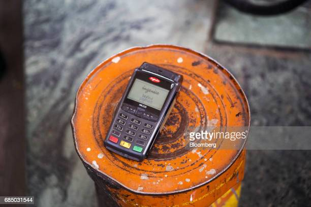 An electronic payment terminal sits on a metal drum at an Indraprastha Gas Ltd gas station in New Delhi India on Wednesday May 17 2017 Indraprastha...