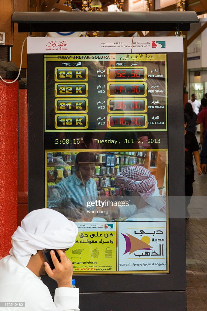 An electronic sign indicates the latest gold trading prices in the Dubai Gold Souk in the Deira district of Dubai, United Arab Emirates, on Tuesday, July 2, 2013. Gold swung between gains and losses in London as investors weighed prospects for increased physical demand against a slowing stimulus in the U.S. Photographer: Duncan Chard/Bloomberg via Getty Images