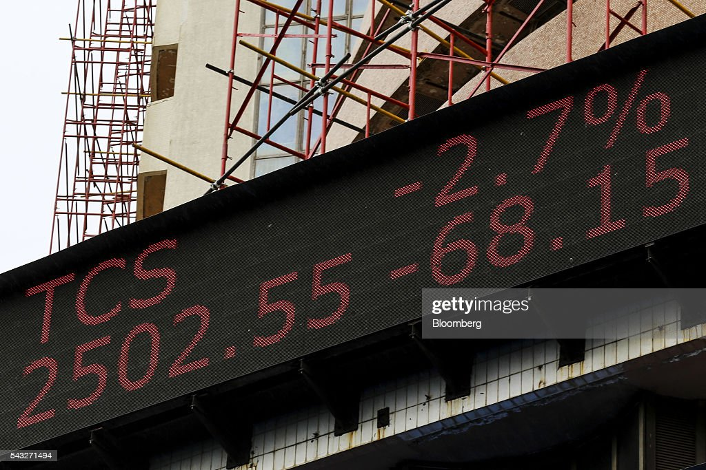An electronic ticker board displays the stock figures for Tata Consultancy Services Ltd. (TCS) at the Bombay Stock Exchange (BSE) in Mumbai, India, on Monday, June 27, 2016. Most Indian stocks advanced, led by companies tied to the economy, as some investors judged Friday's Brexit-induced selloff is overdone. TCS and Infosys Ltd., India's top software exporters that earn about a quarter of their revenue from Europe, were the biggest losers on the benchmark S&P BSE Sensex. Photographer: Dhiraj Singh/Bloomberg via Getty Images