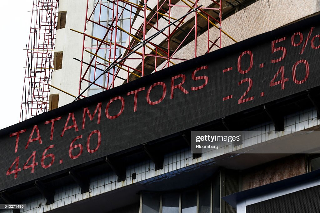 An electronic ticker board displays the stock figures for Tata Motors Co. at the Bombay Stock Exchange (BSE) in Mumbai, India, on Monday, June 27, 2016. Most Indian stocks advanced, led by companies tied to the economy, as some investors judged Friday's Brexit-induced selloff is overdone. Tata Consultancy Service Ltd. (TCS) and Infosys Ltd., India's top software exporters that earn about a quarter of their revenue from Europe, were the biggest losers on the benchmark S&P BSE Sensex. Photographer: Dhiraj Singh/Bloomberg via Getty Images