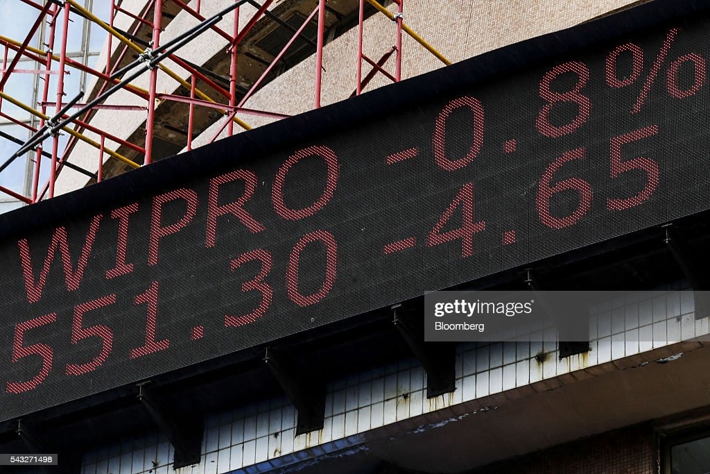 An electronic ticker board displays the stock figures for Wipro Ltd. at the Bombay Stock Exchange (BSE) in Mumbai, India, on Monday, June 27, 2016. Most Indian stocks advanced, led by companies tied to the economy, as some investors judged Friday's Brexit-induced selloff is overdone. Tata Consultancy Service Ltd. (TCS) and Infosys Ltd., India's top software exporters that earn about a quarter of their revenue from Europe, were the biggest losers on the benchmark S&P BSE Sensex. Photographer: Dhiraj Singh/Bloomberg via Getty Images