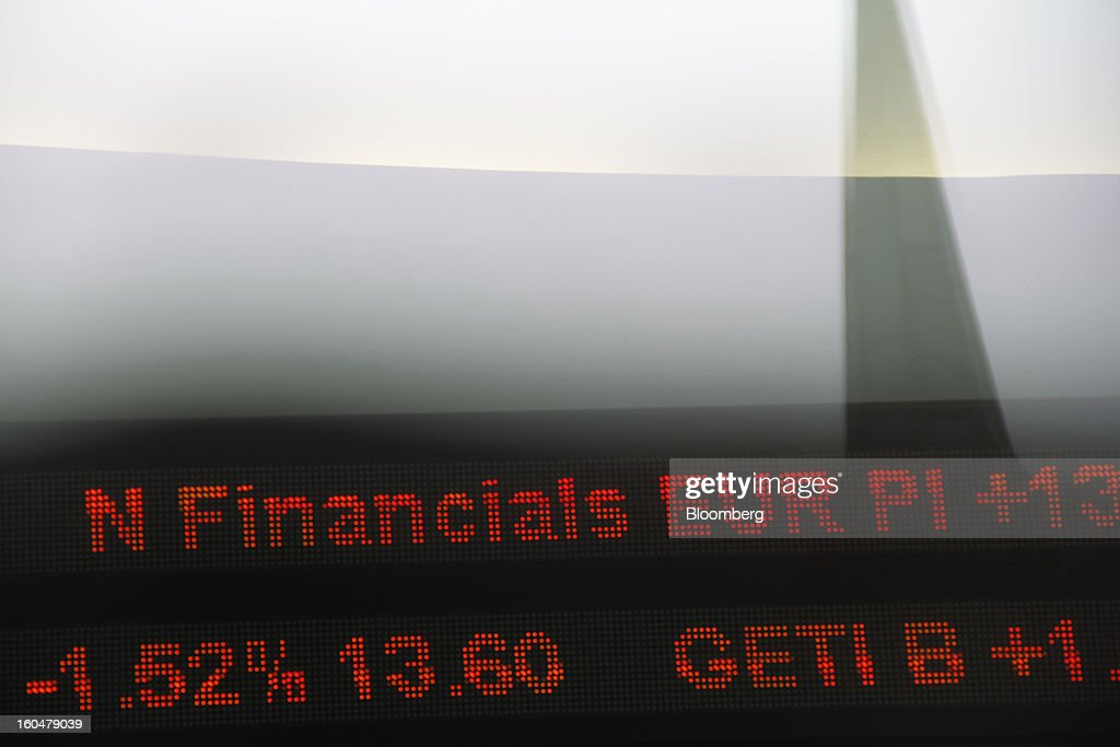 An electronic ticker board indicates stock prices inside the Copenhagen Stock Exchange in Copenhagen, Denmark, on Friday, Feb. 1, 2013. Danish regional banks are struggling to emerge from a burst property bubble that's forced the government resolution agency to take over a dozen lenders after losses on commercial and agricultural loans wiped out capital. Photographer: Freya Ingrid Morales/Bloomberg via Getty Images