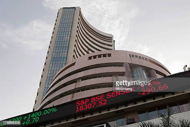 An electronic ticker board indicates the closing figures of the SP BSE Sensex at the Bombay Stock Exchange building in Mumbai India on Monday Aug 19...