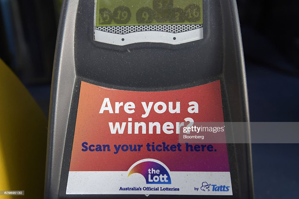 An electronic ticket scanner by Tatts Group Ltd. stands on a counter at a newsagent's store in Melbourne, Australia, on Thursday, Dec. 15, 2016. A consortium including Morgan Stanley and KKR & Co. offered as much as A$7.3 billion ($5.5 billion) for Australian betting and lotteries business Tatts Group, setting up a potential bidding war with Tabcorp Holdings Ltd. Photographer: Carla Gottgens/Bloomberg via Getty Images