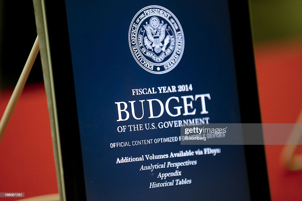 An electronic version of the Fiscal Year 2014 Budget is shown on an Apple Inc. iPad at the U.S. Government Printing Office in Washington, D.C., U.S., on Monday, April 8, 2013. Less than a week after job-creation figures fell short of expectations and underscored the U.S. economy's fragility, President Barack Obama will send Congress a budget that doesn't include the stimulus his allies say is needed and instead embraces cuts in an appeal to Republicans. Photographer: Andrew Harrer/Bloomberg via Getty Images