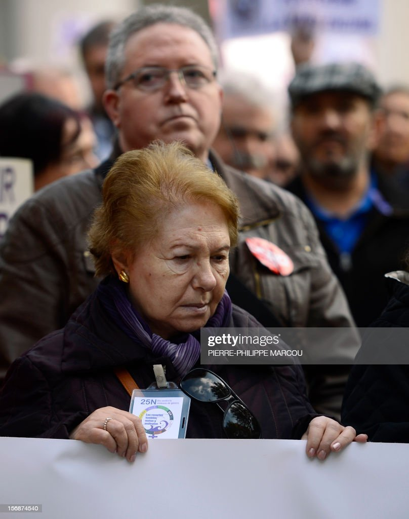An elederly woman takes part in a protest against domestic violence in Madrid on November 23, 2012.