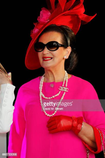 An elegant racegoer poses on stage at the Best Dressed award at Ladies Day at The 2017 Randox Health Grand National Festival at Aintree Racecourse on...