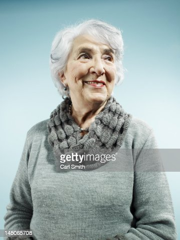 An elegant senior woman smiling and looking away