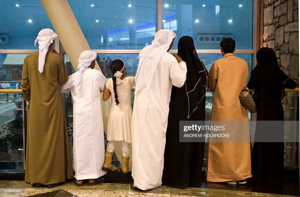 An elegantly dressed family from the Emirates shops at the Mall of the Emirates