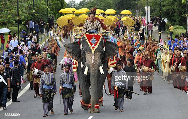 An elephant leads a farewell procession for the outgoing 13th king of Malaysia Tuanku Mizan Zainal Abidin and Queen Nur Zahirah leading to the Bunga...