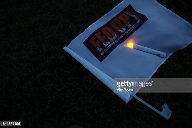 An eletronic candle is placed on a FED UP flag during a candlelight vigil at the Ellipse August 31 2017 in Washington DC FED UP Coalition hosted its...