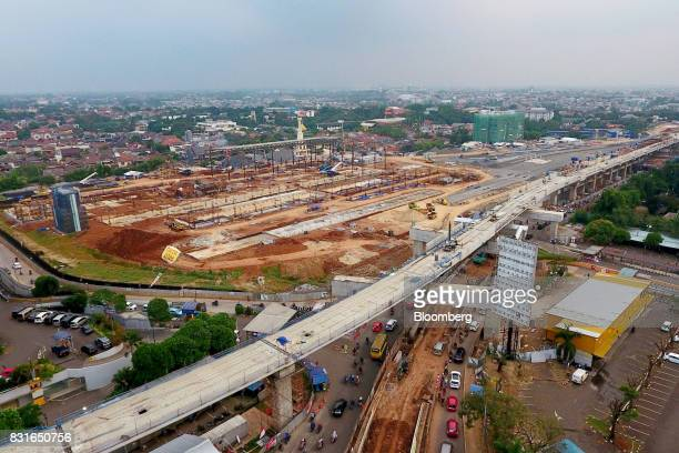An elevated track for the Jakarta Mass Rapid Transit foreground and the Lebak Bulus MRT station stand under construction in this aerial photograph...