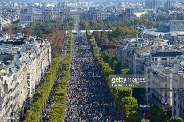 An elevated view as tourists and Parisians enjoy the Champs Elysées during the 2016 carfree day organised in Paris across 45% of the area of the city...