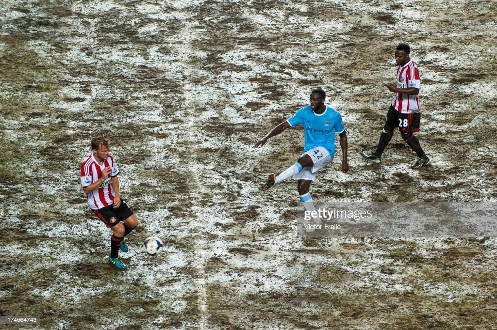 An elevated view of the pitch as Yaya Toure of Manchester City competes for the ball with Sebastian Larsson (L) and Stephane Sessegnon (R) of Sunderland AFC during the Barclays Asia Trophy Final match between Manchester City and Sunderland at Hong Kong Stadium on July 27, 2013 in So Kon Po, Hong Kong.