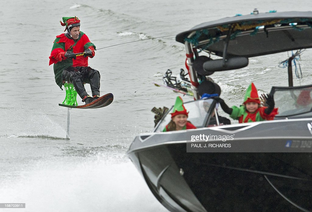 An elf on a waterski chair rides on the Potomac River at National – Waterski Chair
