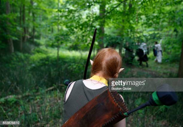 An elf stalks her prey during a woods battle at Ragnarok XXXII on June 22 2017 For one week each summer the World has come to an end as over 1000...