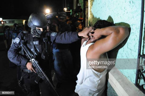 An elite police officer arrests an alleged member of the Mara Salvatrucha gang in San Juan Opico La Libertad 40 km West of San Salvador El Salvador...