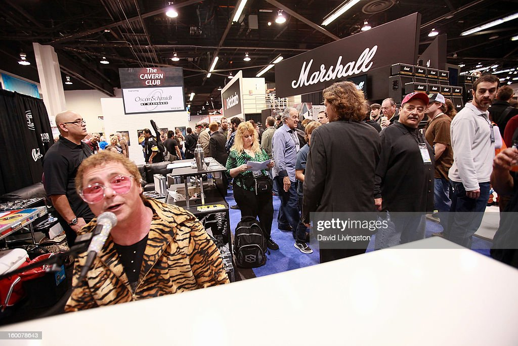 An Elton John impersonator (L) performs at the 2013 NAMM Show - Day 2 at the Anaheim Convention Center on January 25, 2013 in Anaheim, California.