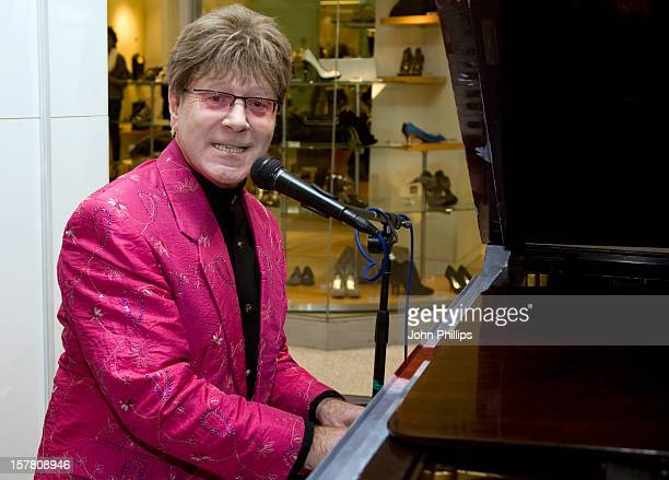 An Elton John Lookalike Performs At The Plaza Shopping Centre In Central London To Promote A Competition Where Customers Can Vote To Donate A Grand...