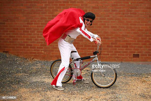 An Elvis enthusiast in a jumpsuit poses on BMX bike before taking part in the street paradeduring the Parkes Elvis Festival on January 10 2015 in...