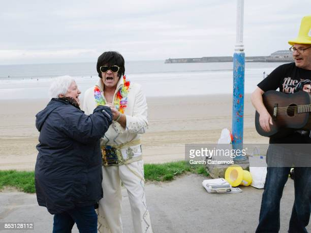 An Elvis impersonator dances with a member of the public at 'The Elvies' on September 24 2017 in Porthcawl Wales 'The Elvies' is an annual gathering...