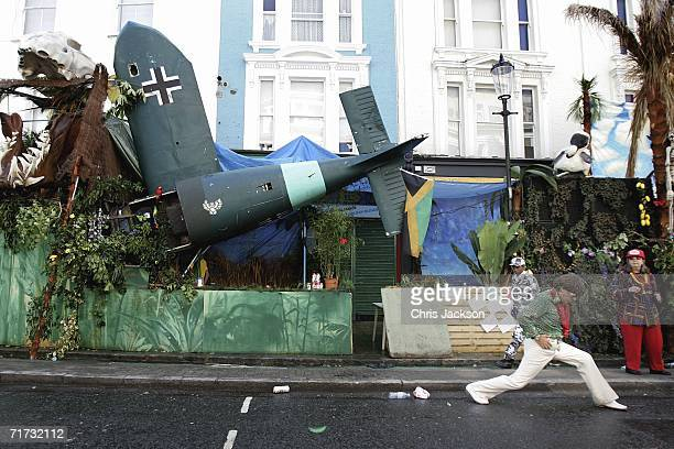 An Elvis impersonator is seen in front of a festival installation during the annual Notting Hill Carnival on August 28 2006 in London England The...