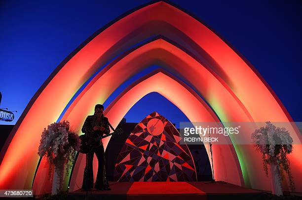 An Elvis impersonator waits to perform at a wedding ceremony in a chapel at the Rock in Rio USA music festival May 16 at the MGM Resorts Festival...