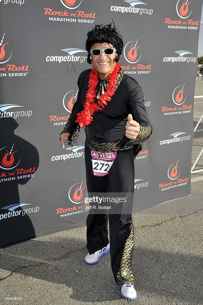 An Elvis Presley impersonator arrives at the Zappos.com Rock 'n' Roll Las Vegas Marathon and Half-Marathon on December 2, 2012 in Las Vegas, Nevada.
