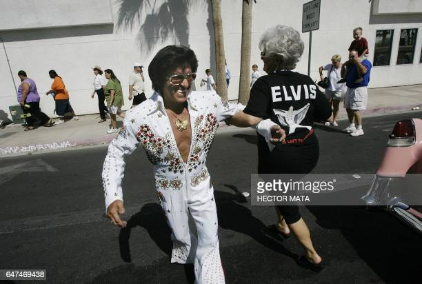 An Elvis Presley impersonator dances with a woman before participating in the 'Helldorado' Parade in Las Vegas 14 May 2005 The Helldorado Parade was...