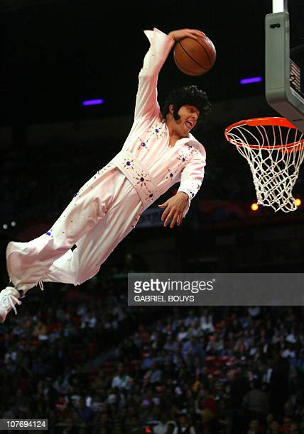 An Elvis Presley lookalike slam dunks the ball during the slam dunk contest of the NBA All Star Game 17 February 2007 in Las Vegas Nevada AFP PHOTO /...