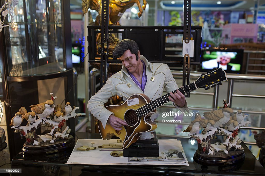 An Elvis Presley statue is displayed for sale in a department store in the Faisal Business Center in Kabul, Afghanistan, Wednesday, Aug. 7, 2013. A smooth U.S. exit from Afghanistan will depend on Pakistans cooperation with the logistical pullout, as well as its backing for peace talks in neighboring Afghanistan and an end to any support for extremist proxies operating there. Photographer: Victor J. Blue/Bloomberg via Getty Images