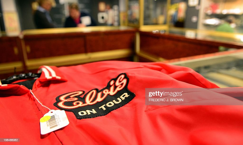 An Elvis Presley tour jacket from his last special tour, worn in Indianapolis, Indiana in June 1977 and estimated between $750 and $800 on display during a press preview at auction house Bonham's in Hollywood, California, on November 15, 2012, where Charlie Chaplin's iconic bowler hat and cane are to go under the hammer in this weekend as part of an auction which also includes the John Lennon nude drawing of himself and Yoko Ono, part of the Lennon lot estomated between $18,000 and $22,000 , among memorabilia from other artists. The hat and cane trademark of Chaplin's Little Tramp character are in 'remarkable condition' and are estimated to go for between $40,000 and $60,000 at the sale by auction house Bonhams on Sunday November 18. AFP PHOTO / Frederic J. BROWN