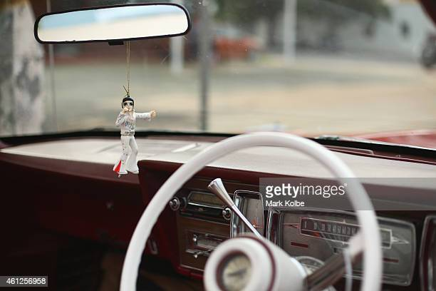 An Elvis rear vision mirror ornament is seen before the start of the street parade during the Parkes Elvis Festival on January 10 2015 in Parkes...