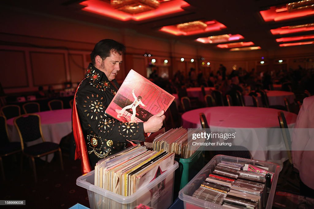 An Elvis tribute artist looks through records for sale during the European Elvis Championships at the Hilton Hotel on January 4, 2013 in Birmingham, England. Elvis impersonators are taking part in three days of competition from which a winner will go forward to the International Elvis Tribute Artist Contest in Memphis, USA.