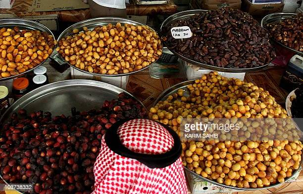 An Emarati buys dates at a market place in Dubai August 29 on the 19th days of the holy month of Ramadan Many Muslims across the world break their...