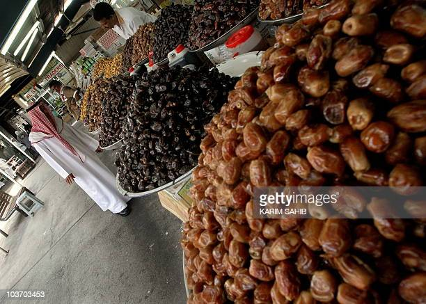 An Emarati chooses dates at a market place in Dubai August 29 on the 19th days of the holy month of Ramadan Many Muslims across the world break their...