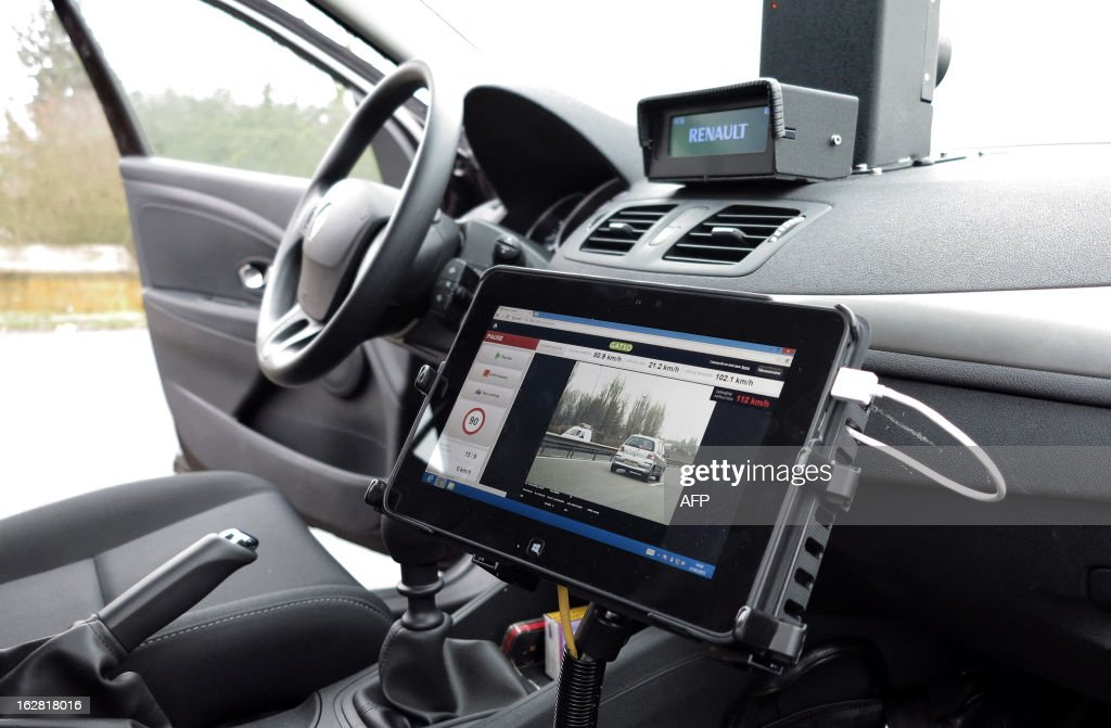 An embedded radar is pictured inside a car on February 27, 2013 in Saclay, outside Paris. This new generation of radar that will fight against high exes speed, will become effective on March 15, 2013 in twenty departments, announced Road Safety on February 28, 2013.