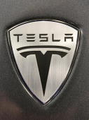 An emblem of one of Tesla Motors Inc's Roadsters is seen at the company's headquarters in Palo Alto California US on Thursday May 20 2010 Toyota...