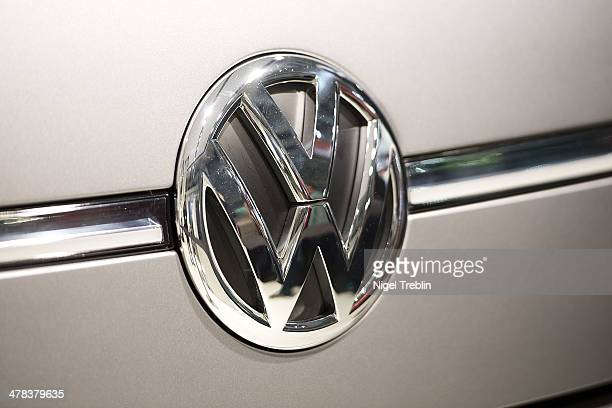 An emblem of Volkswagen is pictured at the 2014 CeBIT technology Trade fair on March 13 2014 in Hanover Germany CeBIT is the world's largest...