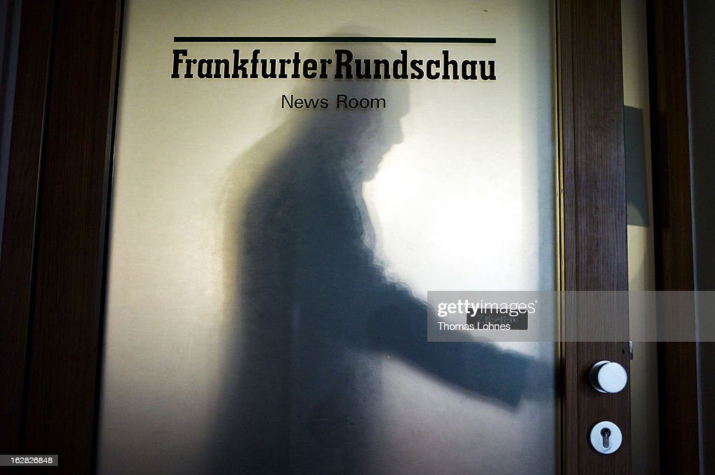 An embloye leaves the News Room of the Frankfurter Rundschau on February 28, 2013 in Frankfurt am Main, Germany. The Frankfurter Rundschau has been bought by the Frankfurter Allgemeine Zeitung after the Federal Cartel Office in Bonn allowed the acquisition on Wednesday afternoon.