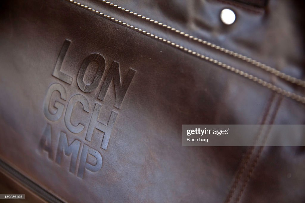 An embossed leather Longchamp logo is seen on a bag at the Longchamp SAS workshop in Segre, France, on Monday, Sept. 9, 2013. Longchamp SAS, the French handbag maker, which is known for foldable Le Pliage nylon tote bags, expects sales in China to rise, Chief Executive Officer Jean Cassegrain said. Photographer: Balint Porneczi/Bloomberg via Getty Images