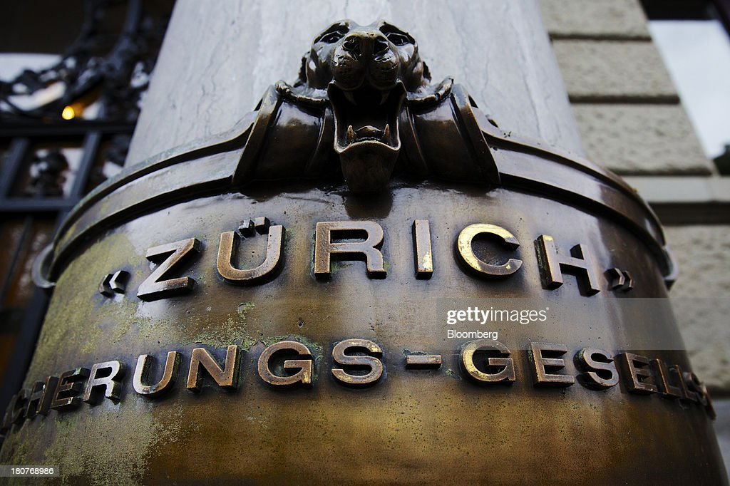 An embossed sign sits on a pillar outside Zurich Insurance Group AG's headquarters in Zurich, Switzerland, on Monday, Sept. 16, 2013. Zurich Insurance named Tom de Swaan chairman, replacing Josef Ackermann, who stepped down after the suicide of Chief Financial Officer Pierre Wauthier. Photographer: Gianluca Colla/Bloomberg via Getty Images