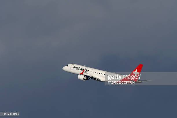 An Embraer ERJ190LR commercial plane of Helvetic Airways low cost company takes off on January 15 2017 at Zurich Airport / AFP / FABRICE COFFRINI