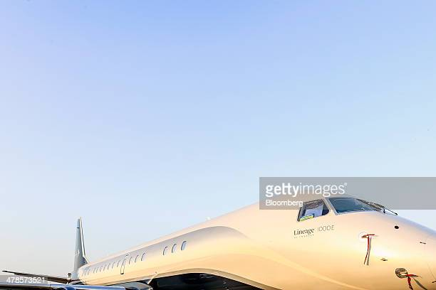 An Embraer SA Lineage 1000E business jet sits on display during the India Aviation 2014 air show held at the Begumpet Airport in Hyderabad India on...