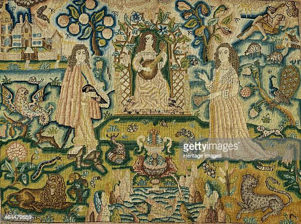 An embroidered panel with a woman playing a guitar 17th century A garden scene The woman sits in front of a fountain with a man and woman on either...