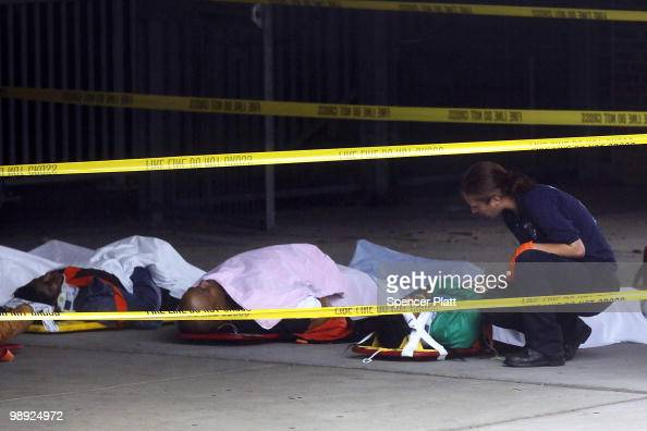 An emergency personnel counsels the injured following the crash of the Staten Island Ferry into a dock in the city's borough of Staten Island on May...