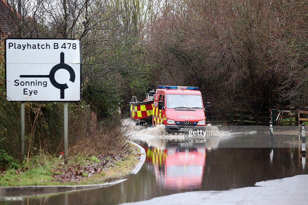 An emergency service vehicle towing a boat drives through flood waters from the River Thames on December 29, 2012 in Sonning, England. The Environment Agency has issued widespread flood warnings across the UK whilst the Met Office has predicted further rain forecast for the remainder of 2012, which is likely to be recorded as the wettest year since records began in 1910.